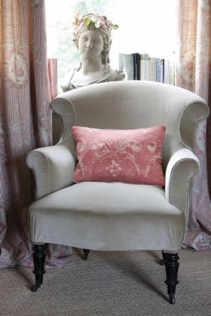 Kate Forman -  Kate Forman Fabric Collection - Plain minerral blue upholstered classic armchair with a red pillow and red and white striped curtains imprinted with wreaths