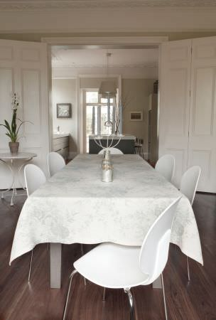 Kate Forman -  Kate Forman Fabric Collection - Classic white tablecloth with light grey flower impressions in a modern dining room setting