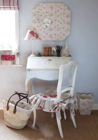 Kate Forman -  Kate Forman Fabric Collection - White classic seating pad with flower motifs, a notice board covered in white flowery fabric, and a red striped roman blind