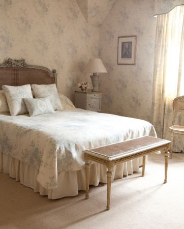 Kate Forman -  Kate Forman Fabric Collection - Bed set with white bed sheets and pillow covers with classic blue floral design and wall paper with faded blue flower images