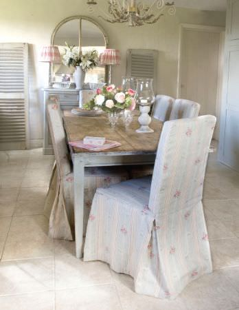 Kate Forman -  Kate Forman Fabric Collection - Blue and white Cath Kidston chair covers with red bouquets in a rustic dining room
