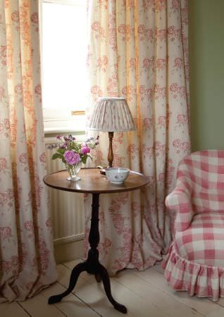 Kate Forman -  Kate Forman Fabric Collection - White curtains with simple but detailed flower prints and a red and white plaid armchair upholstery for a country house style