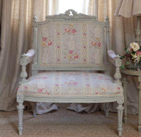 Kate Forman -  Kate Forman Fabric Collection - Antique bench with classic style light blue padding decorated with red and pink bands of wraths and flowers