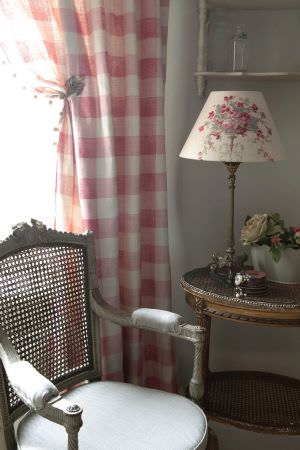 Kate Forman -  Kate Forman Fabric Collection - Red and white tartan curtain and a white lamp shade with a red flower bouquet