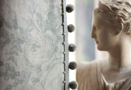 Kate Forman -  Kate Forman Fabric Collection - Close-up of an antique style curtain showing detailed blue/grey flower print