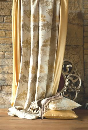 Kestrel Lister -  Acacia Fabric Collection - Lustrous light gold curtains and a cushion, with white curtains and a cushion printed with gold and pewter tree designs
