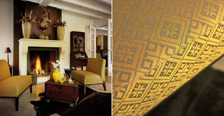 Kobe -  Ambiance Fabric Collection - Low, simple chairs with light brown and lustrous golden honey coloured patterns, with a wooden chest, and an animal skin rug