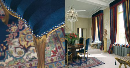Kobe -  Augusta Fabric Collection - Blue striped chairs with gold frames around a table, with red, blue and gold striped curtains, and a co-ordinating rug
