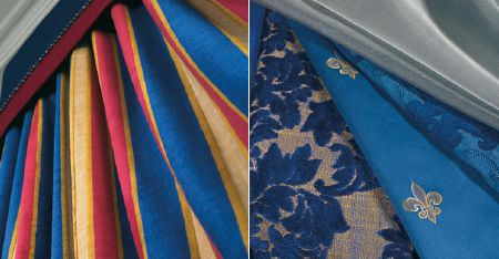 Kobe -  Augusta Fabric Collection - Grey and Royal blue plain, floral and fleur de lis patterned fabrics, with bright red, blue and gold striped curtains
