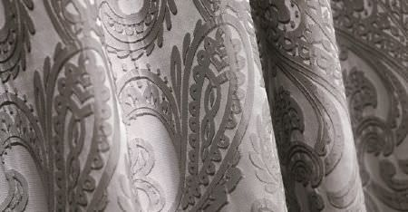 Kobe -  Camden Fabric Collection - Smoke grey coloured paisley shapes printed with white highlights on folds of light silvery grey coloured fabric
