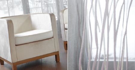 Kobe -  Camden Fabric Collection - Overlapping, subtle, wavy lines on very thin, sheer white curtains, with a plain cream tub style armchair on a wood base