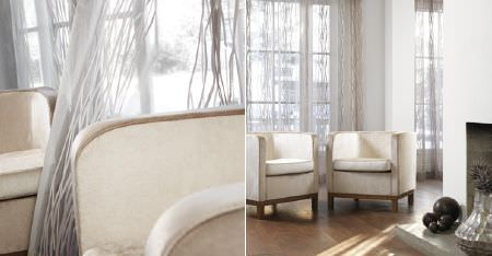 Kobe -  Camden Fabric Collection - Two plain cream tub style armchairs with wooden bases, with sheer white curtains patterned with thin, subtle, wavy lines