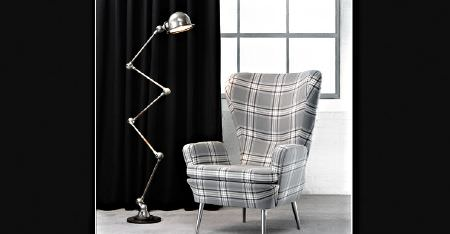 Kobe -  Courchevel CS Fabric Collection - A silver anglepoise floor lamp with a light grey and white checked armchair in front of plain jet black cushions