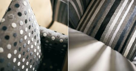 Kobe -  Esmeraldo Fabric Collection - Textured polka dot and striped fabrics covering chairs in white and various dark shades of grey