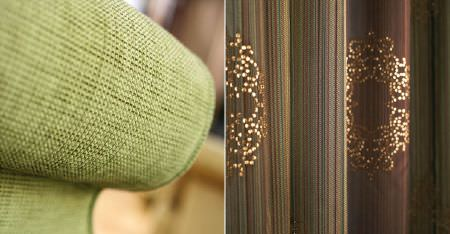 Kobe -  Esmeraldo Fabric Collection - The arm of a plain light green chair, with folds of plain and striped dark brown and green fabric, with shiny gold patterns
