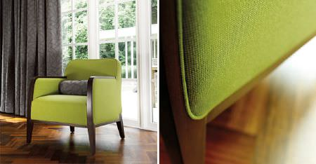 Kobe -  Expression Fabric Collection - A plain lime green coloured armchair with a brown wood frame, with a grey patterned bolster cushion and matching curtains