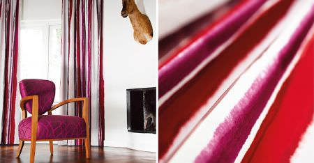 Kobe -  Expression Fabric Collection - Bright fuschia, red and white stripes on fabric and curtains, with a wood framed, patterned fuschia armchair, and a stag head