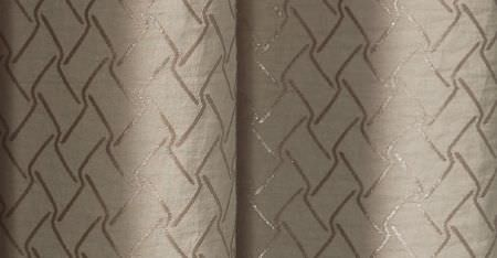 Kobe -  Inoxy Fabric Collection - A shimmering pewter coloured pattern of short, wavy lines printed in a regular pattern on folds of putty coloured fabric