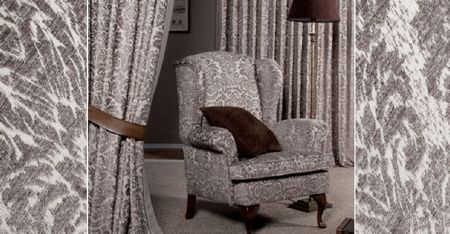 Kobe -  Jockey Fabric Collection - A dark brown cushion, tieback and lamp, with grey and white patterned curtains and a padded armchair