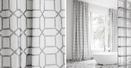 Kobe -  Louvre Fabric Collection - Patterned grey geometric shape prints on white curtains, with a patterned floor, white bathtub and a glass brick wall