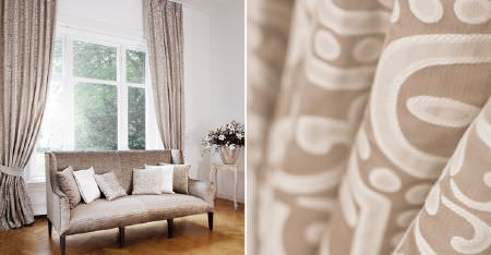 Kobe -  Louvre Fabric Collection - A luxurious, light fudge coloured sofa, with light brown and cream patterned curtains and tiebacks, with 6 scatter cushions
