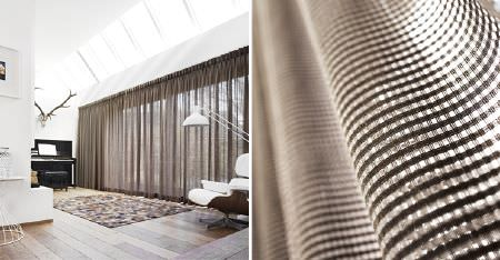 Kobe -  Maroa Fabric Collection - Curtains made from sheer fabric woven in dark and light shades of brown, with a black piano, patterned rug and white chair