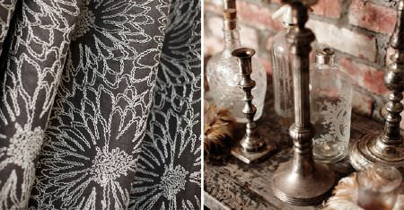 Kobe -  Maroa Fabric Collection - Charcoal coloured fabric embroidered with a large white floral design, with etched glass bottles and bronze candlesticks
