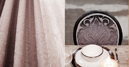 Kobe -  Mystic Fabric Collection - Subtly patterned, textured baby pink fabric, with a textured dark grey-brown seat to a black framed chair, with crockery