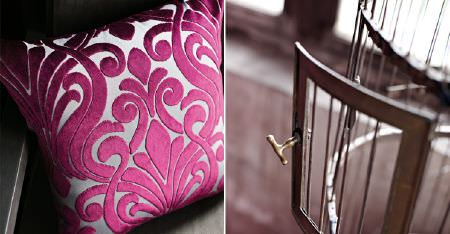 Kobe -  Mystic Fabric Collection - A birdcage beside a grey chair with a silver square cushion featuring a large, cerise, raised, velvet textured pattern