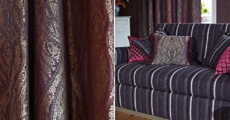 Kobe -  Nomad Fabric Collection - A sofa covered in dark grey, purple and white fabric, with dark purple fabric featuring a shimmering, ornate gold pattern