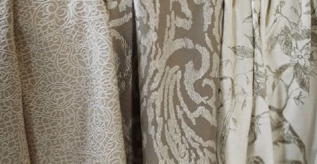 Kobe -  Nomad Fabric Collection - Three different floral and patterned fabrics, all made in cream and light shades of grey and brown