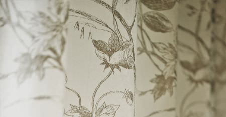 Kobe -  Nomad Fabric Collection - Folds of ivory coloured fabric printed with a delicate, light grey floral pattern