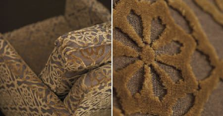 Kobe -  Paladio Fabric Collection - Velvet textured geometric style floral patterns made in a gold colour on a dark brown armchair