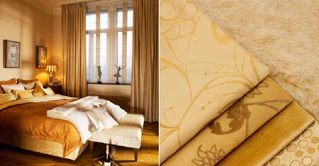 Kobe -  Pearls Fabric Collection - Various plain and subtly patternedcream and honey coloured fabrics on bedding, cushions, curtains and a padded footstool