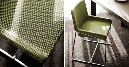 Kobe -  Peru Fabric Collection - A brown table beside an armchair made with a silver metal frame and covered with a subtly patterned light green fabric