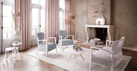 Kobe -  Poetry Fabric Collection - A white rug, light pink curtains, 3 white tables, and 3 armchairs made with white frames and pale pink and blue fabrics