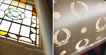 Kobe -  Royal Astoria Fabric Collection - A stained glass window with luxurious mocha and cream coloured fabric featuring a sophisticated wreath pattern