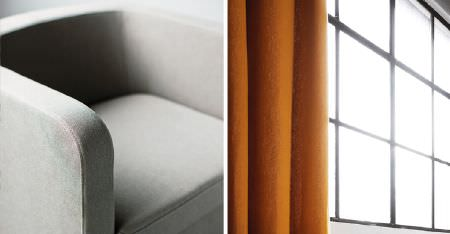 Kobe -  Samba Fabric Collection - Plain burnt orange coloured curtains with a simple padded armchair covered in plain light grey fabric
