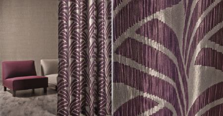 Kobe -  Sensu CS Fabric Collection - Lustrous silver and aubergine coloured patterned curtains with two plain plum and ivory padded chairs, and a fluffy rug