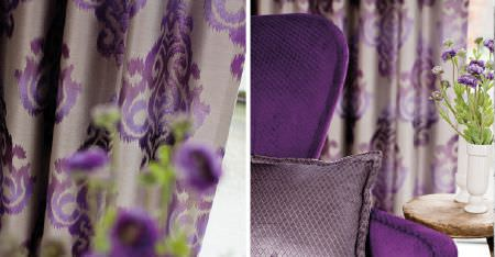 Kobe -  Sindara Fabric Collection - A bright purple armchair, lavender patterned cushion, a table and vase, and curtains patterned in various shades of purple