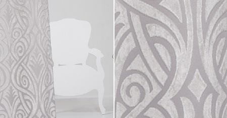 Kobe -  Skimo Fabric Collection - A 2D cut-out of an ornate armchair, beside an elegant, patterned curtain made in bright white and light grey