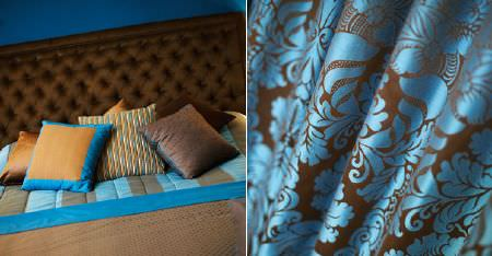 Kobe -  Zaffiro CS Fabric Collection - Aqua blue and dark brown patterned, striped and plain fabrics making up a headboard, bedding and cushions