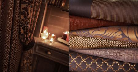 Kobe -  Zaffiro CS Fabric Collection - Candles and a wooden side table, folds of plain and patterned bronze and dark purple fabric, and matching curtains