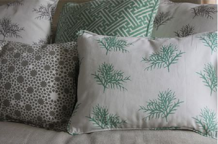 Korla -  Korla Fabric Collection - Branches and geometric shapes covering square and rectangular scatter cushions in white, dark grey and emerald green