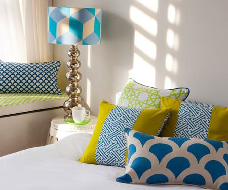 Korla -  Korla Fabric Collection - Plains, scallops and geometric prints on a lampshade and scatter cushions in white, mustard yellow and bright aqua blue