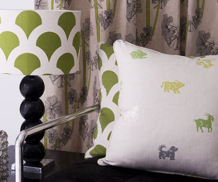 Korla -  Korla Fabric Collection - A zodiac print cushion with a green and white scallop print cushion, a matching lampshade with a black base, and curtains