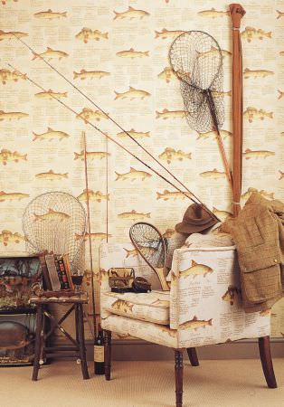 Lewis and Wood -  Lewis And Wood Fabric Collection - A fish print patterned armchair and wallpaper, with fishing rods and nets, a small wooden stool, a jacket and a hat