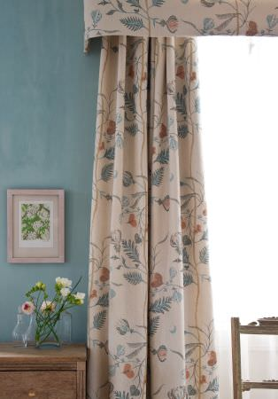 Lewis and Wood -  Lewis And Wood Fabric Collection - Cream, blue and gold-brown patterned curtainswith a matching pelmet, a wooden chair, a chest of drawers and a vase