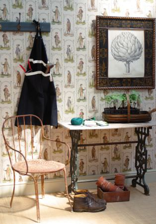 Lewis and Wood -  Lewis And Wood Fabric Collection - A rose gold coloured chair, a cast iron and white table, a framed picture, a coat rack, shoes and patterned wallpaper