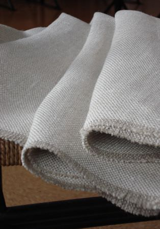 Lewis and Wood -  Lewis And Wood Fabric Collection - Folds of plain fabric made in a very pale shade of grey-white